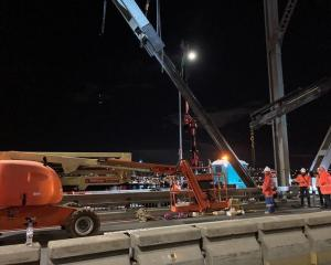 Workers repairing the bridge strut last night. Photo: Supplied / Waka Kotahi NZTA
