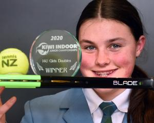 Charlie Byers displays the trophies she won at the national indoor age-grade championships at...