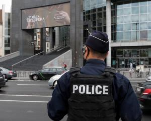 A French police stands near the Opera Bastille where a suspect in a stabbing attack near the...