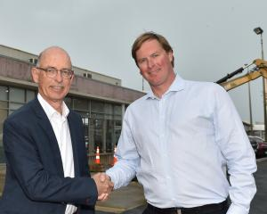 Cooke Howlison managing director John Marsh (left) and Mike's Cars owner Mike Wellington shake...