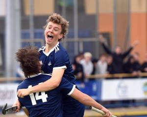 Cromwell College players Ryan Jones (No 14) and William Edwards celebrate Jones' goal against...