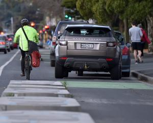 A cyclist is seen going around cars parked over the cycle lane on Great King St on Wednesday...