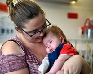 Daxton gets a cuddle from his mum Eden Anderton. Photo: NZ Herald