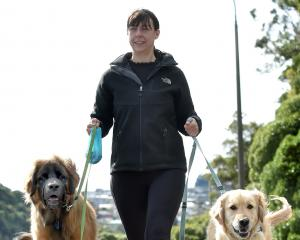 Giving her dogs Arlo (left) and Nero a walk in Portobello Rd yesterday is Jessica Rodger, of...