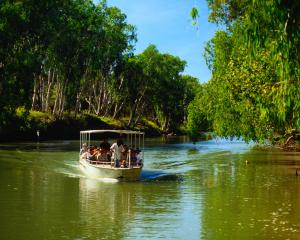 Traveling by boat on the East Alligator River, Kakadu National Park, Northern Territory. Photo:...