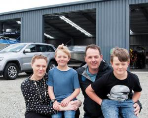 Te Anau owner-operator Christine and Mark Wallace with children Zane and Morgan are ready to ...