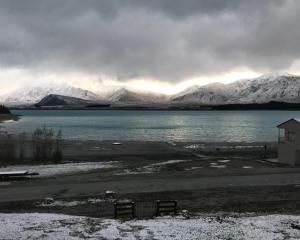 Lake Tekapo earlier this week when a snow storm was passing through. Photo: Supplied via RNZ /...