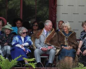 Guest of honour Lady Ellen Elizabeth Reed (in the green hat) sat behind the royal couple when...
