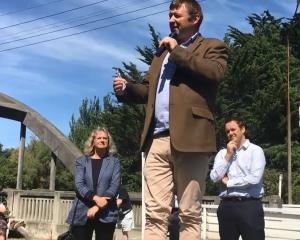 New Zealand First MP Mark Patterson launching his Mataura dross petition in 2019, flanked by...