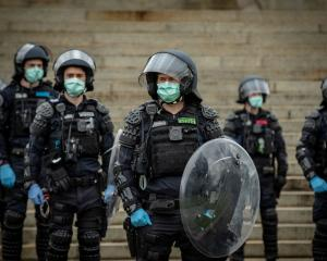 Police officers patrol the Shrine of Remembrance during an anti-lockdown rally in Melbourne on...
