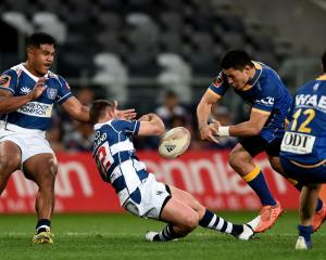 Auckland's Simon Hickey falls after a shoulder charge by Sio Tomkinson. Photo: Getty Images