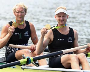 Eric Murray (left) and Hamish Bond celebrate winning the gold medal in the men's pair at the Rio...