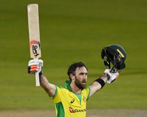Australian batsman Glenn Maxwell celebrates his century against England in this morning's ODI....