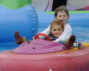 Edie Barber, 6, with her cousin Willow Henson, 2, in an Aqua Boat during last year's Party in the...