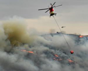 At one point, seven helicopters were tackling an out-of-control burn-off near Macraes yesterday....