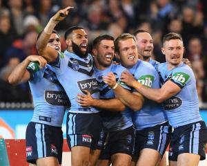James Tedesco celebrates a try with New South Wales team mates during their win last night in the...