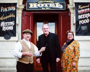 Oamaru Whitestone Civic Trust chairman Graeme Clark (centre) hands the keys to the Criterion...