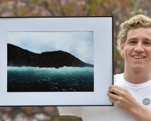 Otago Polytechnic student Oscar Hetherington (19) holds his prize-winning seascape photo. PHOTO:...
