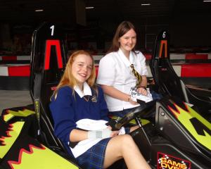 Sophia Gibbons (left) and Georgia Small show off their flaming kart designs. PHOTO: GUY WILLIAMS