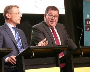 He said what? Labour's Finance Minister Grant Robertson (right) reacts to National's finance...