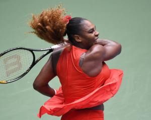 Serena Williams plays a shot during her quarterfinal win at the US Open this morning. Photo: Reuters