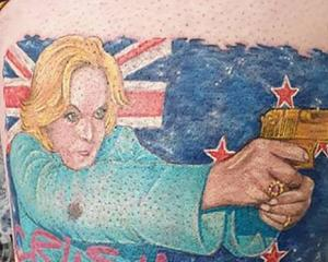 The tattoo of Judith Collins aka Crusher Collins on the leg of National supporter Nik Given of Te...