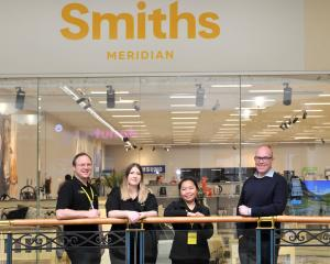 Smiths City staff Mikey Edie-Gray, Angela McDiarmid, Ivy Ardiente and chief executive Tony...