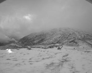 Snow has settled at the summit of the Crown Range Road this morning. Photo: MetService
