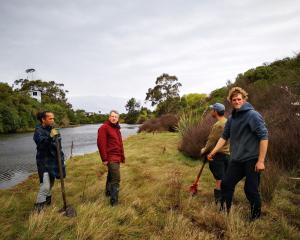 Members of Otokia Creek and Marsh Habitat Trust and volunteers, (from left) Dennis Kahui, Andy...