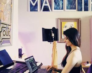 Dunedin musician Molly Devine works on recording music in her home studio, something she has...