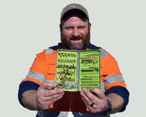 Otago Anglers Association president Mark Barrett displays his collection of trout fishing flies....