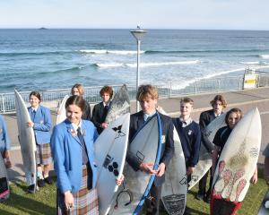 All ready for the national scholastic surfing championships are Otago team members (from left)...