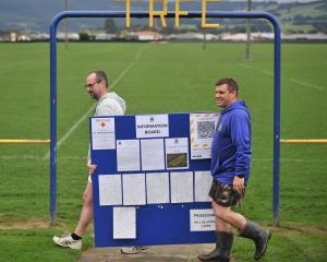 Taieri Rugby Football Club committee member Tony McGrath (left) and junior president Tim Guthrie...