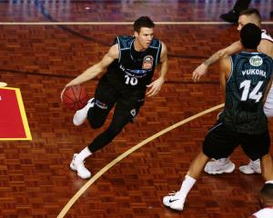 Tom Abercrombie comes off a screen set by Mika Vukona in the Breakers win over the 36ers. Photo:...