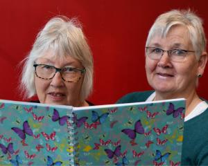 Mosgiel Market co-ordinators Janelle Roguski (left) and Maryanne Ashford read the waiting list of...