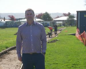 Elmgrove School principal Chris McKinlay stands by the school's new bike track, which is under...