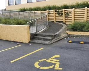 A Reddit user shared the image showing the disabled parking spot next to a ramp with steps to...