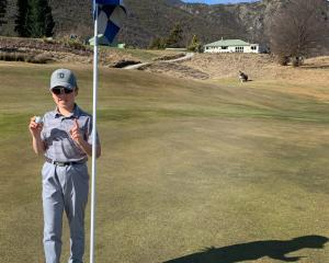 Young Arrowtown golfer Josh Harris celebrates his hole in one at the Arrowtown Golf Club last...