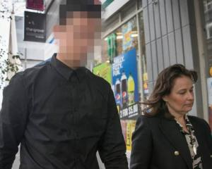 The accused outside the Auckland District Court with his lawyer Emma Priest. Photo: NZ Herald