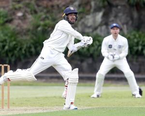 Otago all-rounder Michael Rippon swats a four on his way to a maiden century as Auckland...