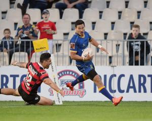 Otago's Sio Tomkinson runs through to score during his side's round 8 Mitre 10 Cup match against...