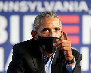 Barack Obama campaigns on behalf of Democratic presidential nominee and his former Vice President...