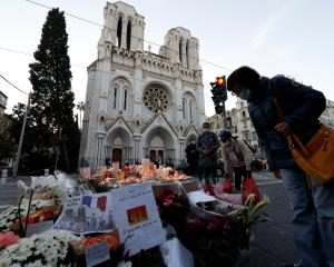 Candles and flowers have been left near the Notre Dame church in Nice in memory of the victims....