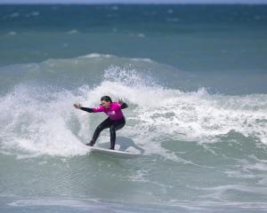 Dunedin surfer Jaya Reardon shows the style which won her a national title at the national...