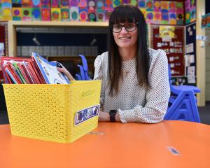 Pine Hill School principal Mel Ward prepares one of her increasingly busy classrooms for the...