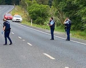 Police at the scene of the shooting. Photo: Buck Lane via NZ Herald