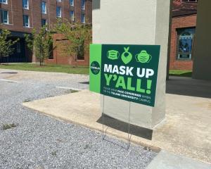 A sign reminds people to wear masks to prevent the spread of Covid-19 at Tulane University in...