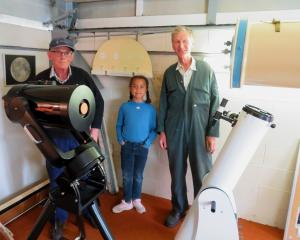 With the telescopes at the Ashburton College observatory are Ken Lucas, Claire Chibanguza and...