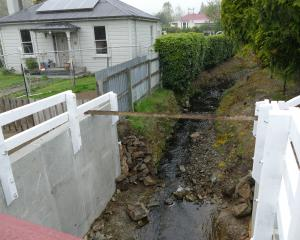 A new culvert channelling the flood-prone Hospital Creek runs beneath Campbelton St in Lawrence.