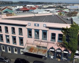 Run-down buildings in Princes St, Dunedin, are for sale. This view is from Stafford St. PHOTO:...